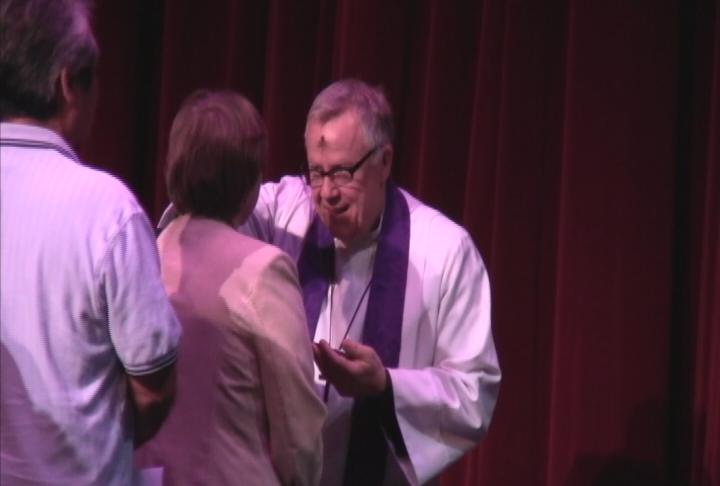 USC students and faculty receive ashes Wednesday at a tri-lateral service at Bovard Auditorium. (Photo Courtesy ATVN)