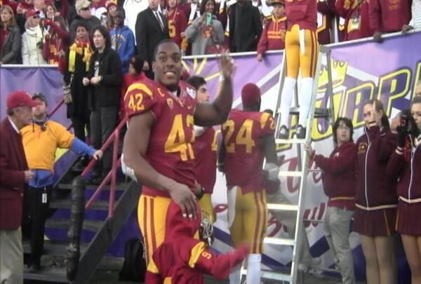 USC linebacker Devon Kennard celebrates the Trojans first postseason victory since 2009.