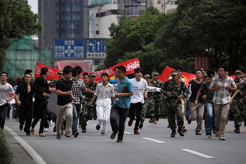 Anti-Japanese protestors in Suzhou, China. (Courtesy of Flickr User markboltonphotography.com)
