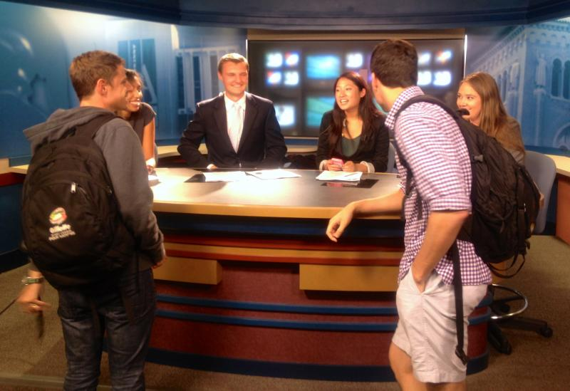 Producers Aaron and Jake talking to the anchors after their show.