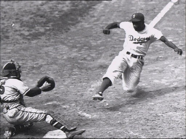 Jackie Robinson stealing home plate (Photo courtesy AP).