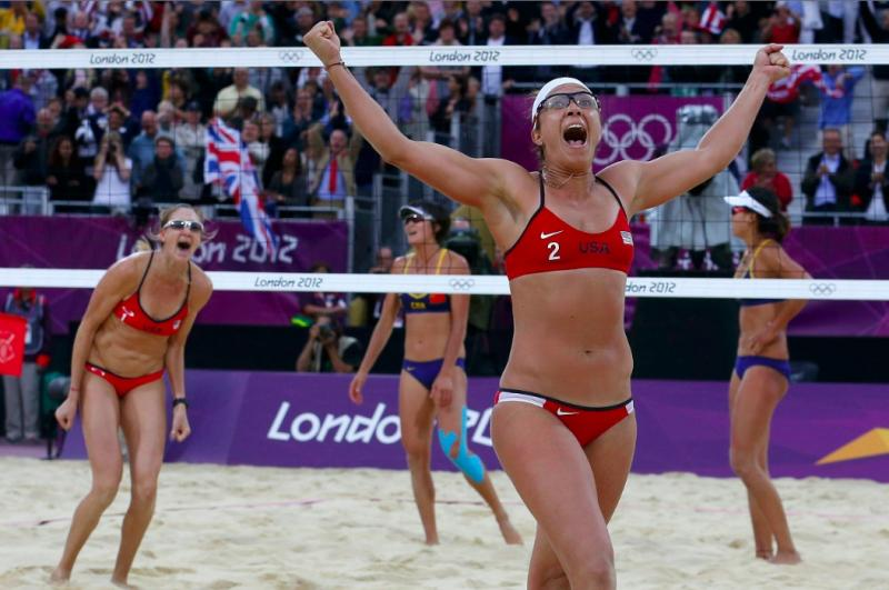 Misty May-Treanor (right) and Kerri Walsh Jennings celebrate winning their women's beach volleyball semifinal match against China's Xue Chen and Zhang Xi at the London Olympics. — SUZANNE PLUNKETT, REUTERS
