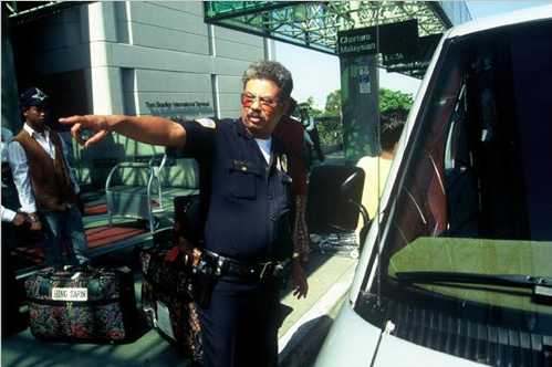 An LAX police officer directs passengers. (Photo courtesy of Los Angeles World Airports)