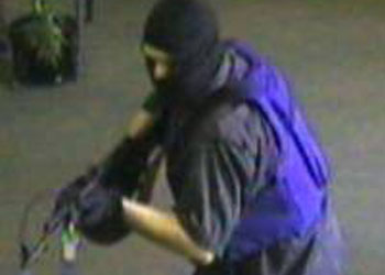 Surveillance video the man, believed to be between 35 and 40 years-old , wearing a ski mask and a carrying a black rifle. (Courtesy  of LAPD)