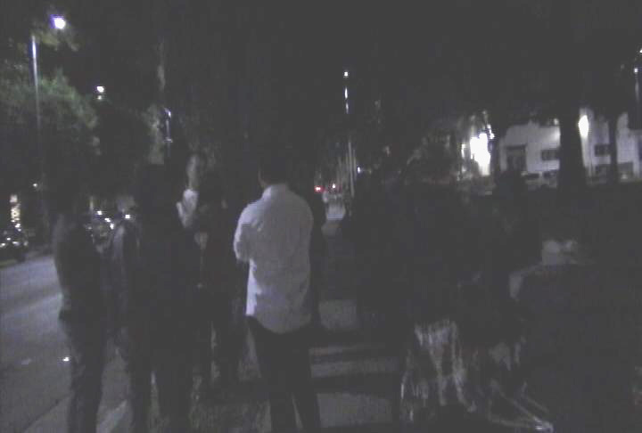 Students at vigil outside Lambda Chi fraternity. (Photo by ATVN)