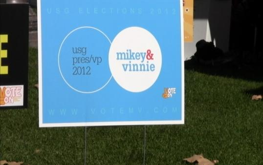 Mikey and Vinnie posters appear throughout campus