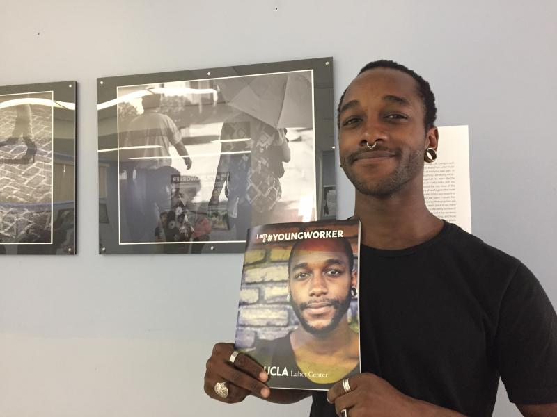 Yoshawn Smith, 24, is a young worker in the restaurant industry. He is pictured on the cover of the new UCLA study. (Carla Javier / Annenberg Media)