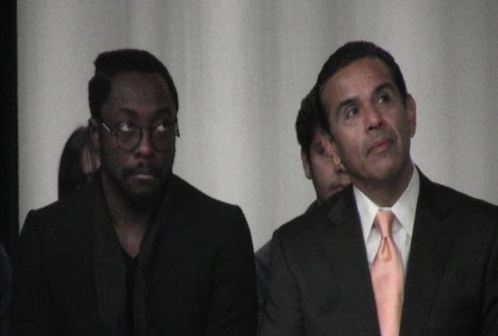 Mayor Antonio Villaraigosa and will.i.am wait to announce a benefits concert in Beijing.