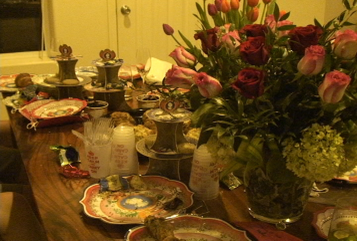 Prince William and Kate Middleton memorabilia decked out this party table, along with scones and fresh flowers.